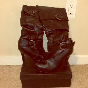Black leather boots with heel